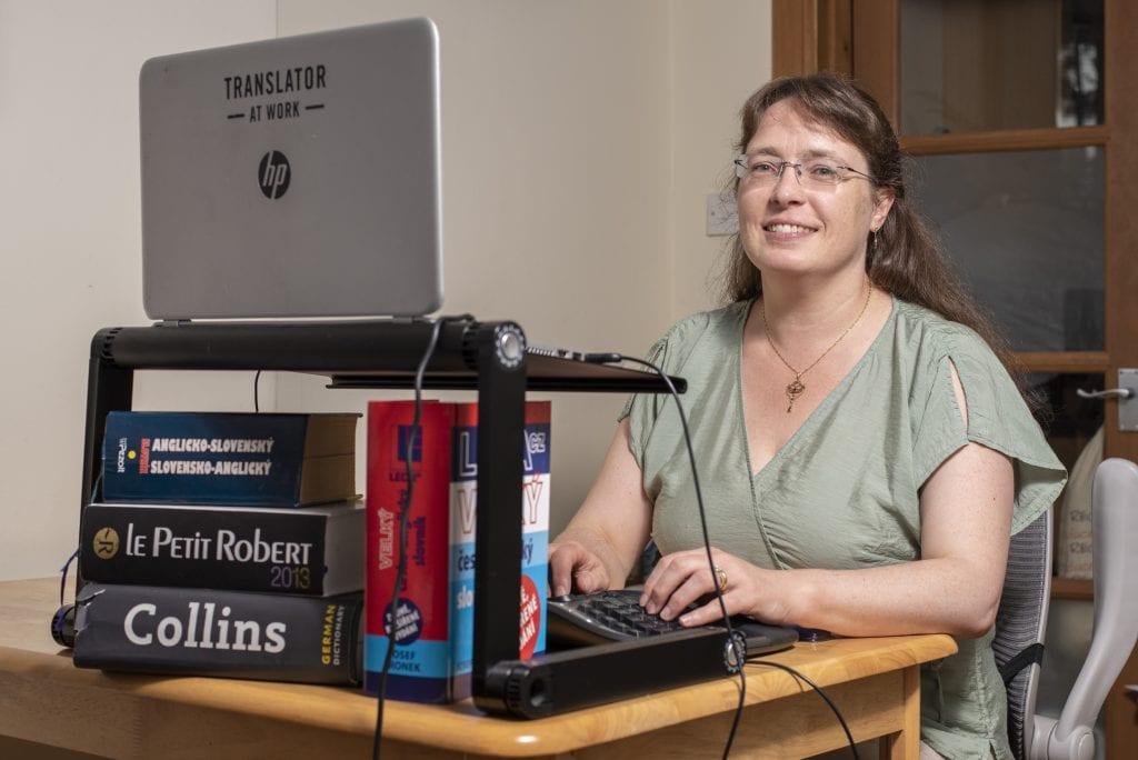 Isabel working at her desk